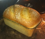 Notice fairly nice oven spring.  You can see through the glass pan that the color of the loaf is still fairly light.  I'm pretty confident that this bread is not done yet.